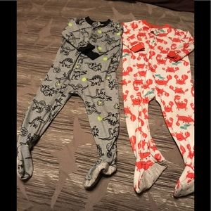 Two zip up footie toddler pajamas. Worn condition